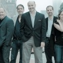 Michael Weber at center with the company of Porchlight Music Theatre