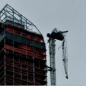 one57 flipped-over crane arm dangles above 57th Street near Carnegie Hall photo by Nancy Malitz