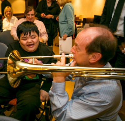 CSO-trombone-Michael-Mulcahy-and-a-young-audience-member-play-a-tune-at-Citizen-Musician-Ronald-McDonald-House-Charities-event-Taipei-credit-Todd-Rosenberg
