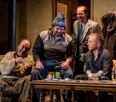 "Everybody's laughing but the troubled Sharky (Dan Waller, right) in this ""Seafarer"" scene with, from left, Brad Armacost, Ira Amyx and Kevin Theis. (Joe Mazza)"
