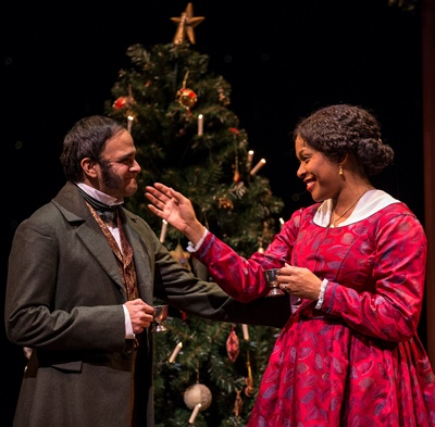 Scrooge's nephew Fred (Anish Jethmalani) and his wife (Tania Richard) celebrate Christmas without the old grouch. (Liz Lauren)
