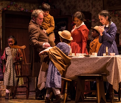 The Cratchit family gathers for Christmas dinner in 'A Christmas Carol' at Goodman Theatre. (Liz Lauren)