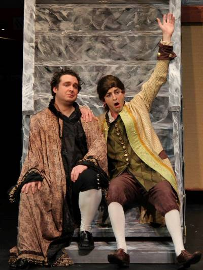 It's been a hard day's night for Leander (Nicholas Pulikowski) and his servant Henrik (Michael Orlinsky) in 'Maskarade.' (Brandon Hayes)