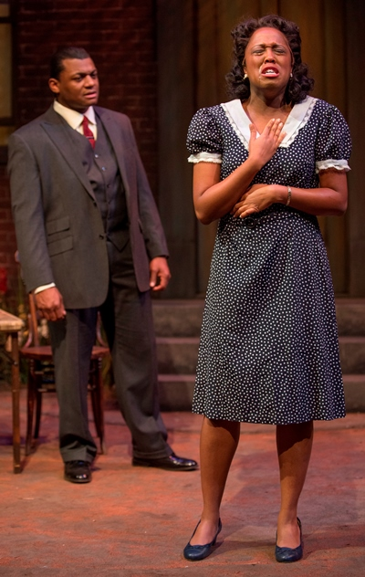 Vera (Ebony Wimbs) still hurts from the last time Floyd (Kelvin Roston, Jr.) betrayed her in August Wilson's 'Seven Guitars.' (Michael Brosilow)