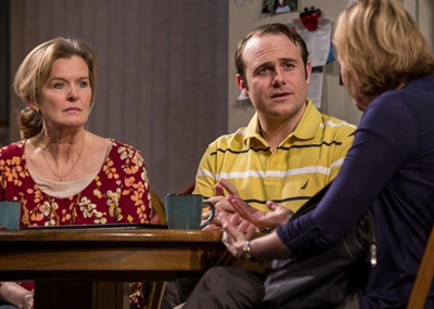 Caroline (Mary Beth Fisher, right) interviews a troubled girl's mother (Jordan Baker) and her pastor (Richard Thieriot). (Liz Lauren)