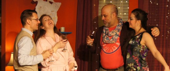 It's a convivial moment -- freeze that frame -- for the two couples in Robert Caisely's 'Happy' at Redtwist. (Jan Ellen Graves)