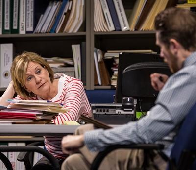 Social worker Caroline (Mary Beth Fisher) mulls a case with her boss (Erik Hellman). (Liz Lauren)