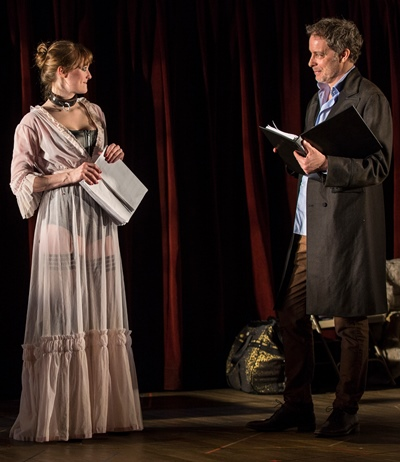 Playwright-director Thomas (Rufus Collins) is impressed by Vanda (Amanda Drinkall) in her first reading of his play. (Liz Lauren)