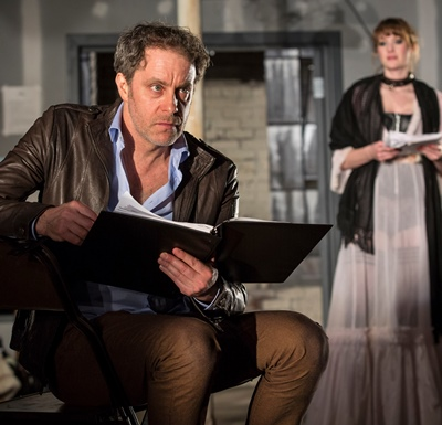 The playwright (Rufus Collins) tries his hand at acting in his own play as Vanda (Amanda Drinkall) looks on. (Liz Lauren)