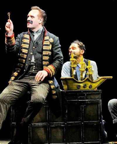 Black Stache (John Sanders) holds the treasure key as his ship stands by in 'Peter and the Starcatcher.' (Jenny Anderson)
