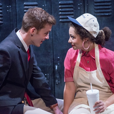 Brandon (Will Kiley) surprises a fast-food worker (Sophia Menendian) with an invitation. (Dean LaPrairie)
