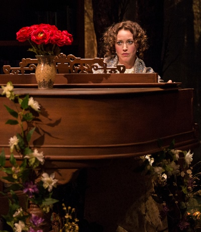 Emma Darwin (Rebecca Spence) plays her flower-bedecked piano. (Liz Lauren)