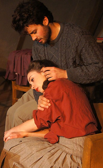Alison (Baize Buzan) finds comfort in the touch of her friend Clilff (Japhet Balaban). (Jan Ellen Graves)