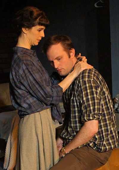 Helena (Lucy Carapetyan) offers solace to Jimmy (Joseph Wiens) in 'Look Back in Anger.' (Jan Ellen Graves)