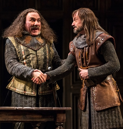 Pistol (Greg Vinkler, left) affirms his friendship with Nym (Larry Neumann Jr.) in 'Henry V.' (Liz Lauren)