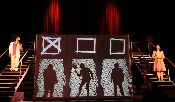 As the King (Andrew Wilkowske) grills the clever girl (Emily Birsan) with riddles, a video projection keeps score. (Liz Lauren)