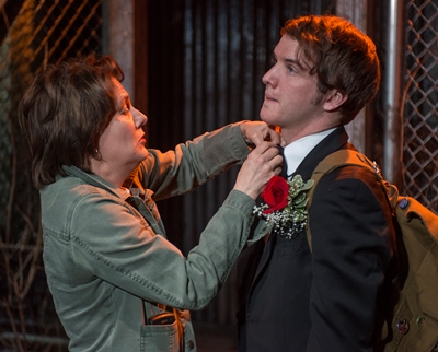 Beth (Natalie West) helps Jonathan (Matt Farabee)  with his bow tie in 'Mud Blue Sky' at A Red Orchid. (Michael Brosilow)
