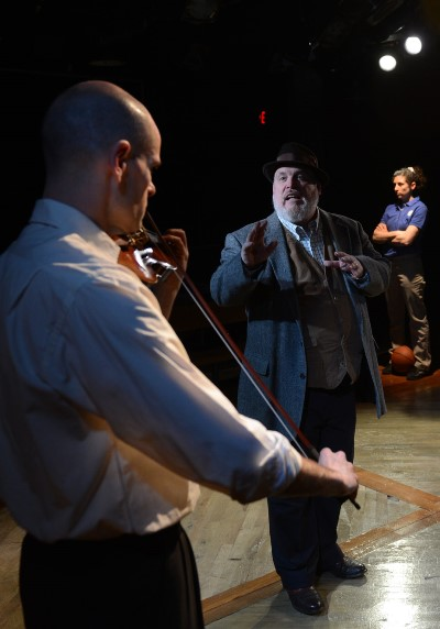Charles Ives (Jamie Vann, middle ground) is the spiritual link between John Starr (Dave Belden) and his daughter Laura (Stephanie Chavara). (Chris Ocken)