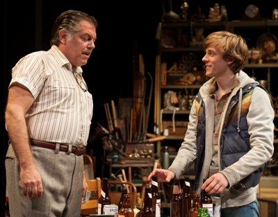 Resale shop owner Donny (Brian Mani) is a father figure to Bobby (Brendan Meyer) in 'American Buffalo' at American Players Theatre. (Zane Williams)