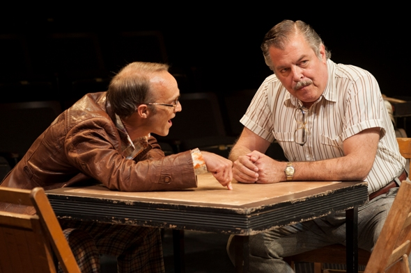 Teach (James Ridge) shares his suspicions with Donny (Brian Mani) in 'American Buffalo' by David Mamet at American Players Theatre. (Zane Williams)