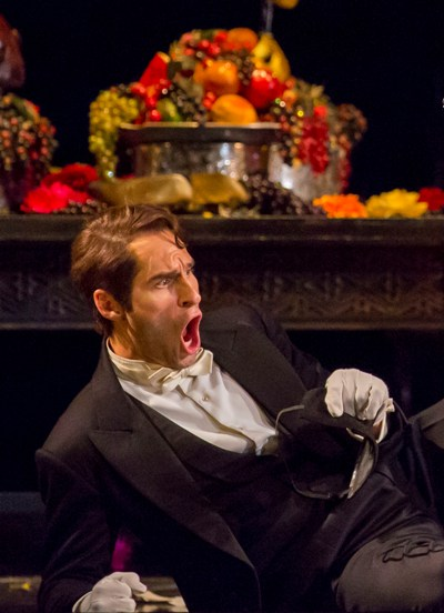 Leporello (Kyle Ketelsen) is always taking the blame for Don Giovanni in Mozart's comic opera at Lyric Opera of Chicago 2014. (Todd Rosenberg)