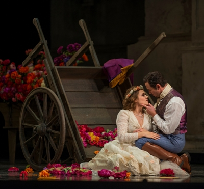 Zerlina (Andriana Chuchman) buys into the sweet lies of Don Giovanni (Mariusz Kwiecień) in Lyric Opera 'Don Giovanni.' (Michael Brosilow)