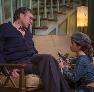 Del (Darrell W. Cox) offers calm counsel to John (Aaron Lamm), eager to go camping with his absent dad. (Michael Brosilow)