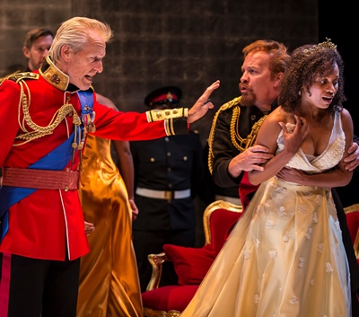 King Lear (Larry Yando, left) disowns his daughter  Cordelia (Nehassaiu deGannes) as Kent (Kevin Gudahl) shields her. (Liz Lauren)