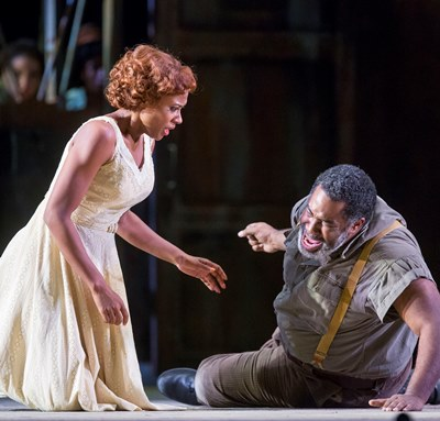 The crippled Porgy (Eric Owens) struggles to be the man for Bess (Adina Aaron). (Todd Rosenberg)