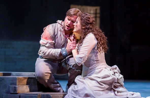 In a brief respite from torture, Cavaradossi (Brian Jagde) finds consolation with Tosca (Tatiana Serjan). (Todd Rosenberg)