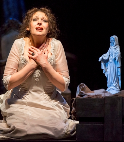 In the aria 'Vissi d'arte,' Tosca (Tatiana Serjan) asks God why she must suffer so much. (Todd Rosenberg)
