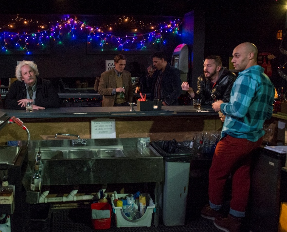 Bar tender Jeffrey (Dominique Worsley, right) and customers in 'Accidentally, Like a Martyr' at A Red Orchid. (Michael Brosilow)