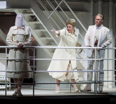 After the war, Liese (Daveda Karanas, center) thinks she sees a woman whose death she caused, in 'The Passenger' at Chicago Lyric 2015. (Michael Brosilow)