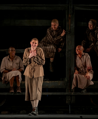Amanda Majeski, standing, is the charismatic Polish prisoner Marta in 'The Passenger' at Chicago Lyric 2015. (Michael Brosilow)