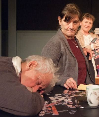 Barbara (Janet Ulrich Brooks) discovers that Uncle Benjamin (Mike Nussbaum) has fallen asleep on his unfinished puzzle. (Lara Goetsch)