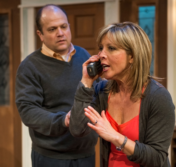Julianna (Lia D. Mortensen) makes a frantic call to her estranged daughter Laurel as husband Ian (Steve Silver) watches with concern. (Michael Brosilow)
