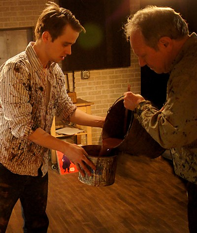 Ken (Aaron Kirby) and Rothko (Brian Parry) mix red paint for a work session. (Jan Ellen Graves)