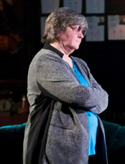 Ann James, here as an imposing King Kreon, switches roles to become a gently resolved Antigone. (Jonathan L. Green)