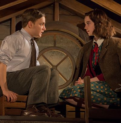 Romance blossoms in the attic for Anne (Sophie Thatcher) and Peter (Antonio Zhiurinskas). (Michael Brosilow)