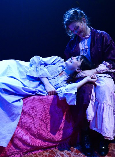 Eldest sister Olga (Mary Williamson) comforts the youngest, Irina (Hilary Williams). (Evan Hanover)