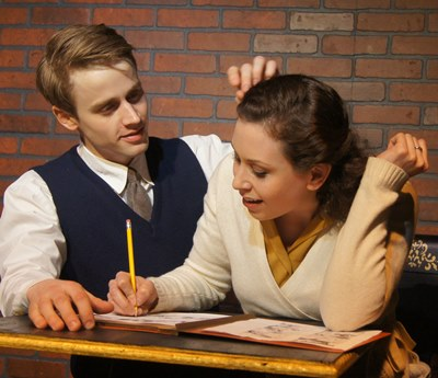 Lee (Aaron Kirby) has more than commas on his mind as he chats up a communist-leaning editor (Sarah R. Sapperstein). (Tommy Lee Johnston)