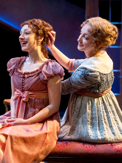 The Dashwood sisters Marianne (Megan McGinnis) and Elinor (Sharon Rietkerk) dream about their futures in 'Sense and Sensibility' at Chicago Shakespeare Theater 2015 (Liz Lauren)