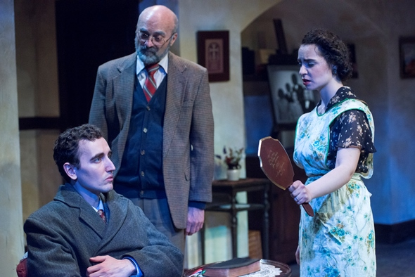 Tomasian (Matt Browning) shrinks within his dead father's coat as Seta (Sophia Menendian) and the Gentleman (Ron Quade) look on. (Dean LaPrairie)