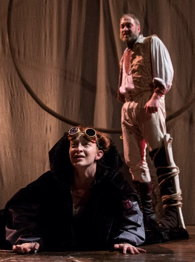 Capt. Ahab (Christopher Donahue) stands over a dying whale (Emma Cadd) on the deck of the Pequod. (Liz Lauren)