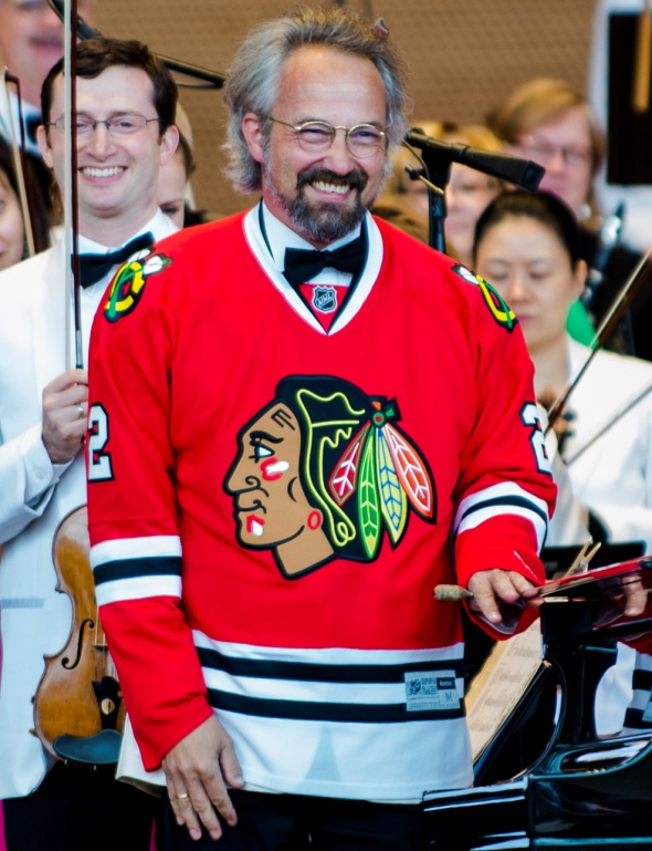Carlos Kalmar honors the Blackhawks' Stanley Cup win on opening night at the Grant Park Music Festival June 17, 2015. (Norman Timonera)