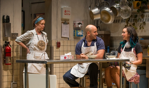 A happy interlude in the soup kitchen for Shelley (Mariann Mayberry, left), Oscar (Victor Almanzar) and Emma (Brittany Uomoleale). (Michael Brosilow)
