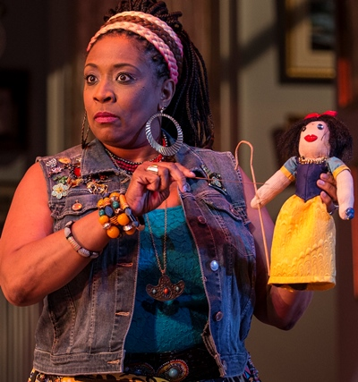 Cassandra (E. Faye Butler) works a bit of voodoo on a Snow White effigy of Masha. (Liz Lauren)