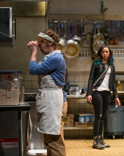 Emma (Brittany Uomoleale) catches Shelley (Mariann Mayberry) clocking herself at prayer with the microwave timer. (Michael Brosilow)