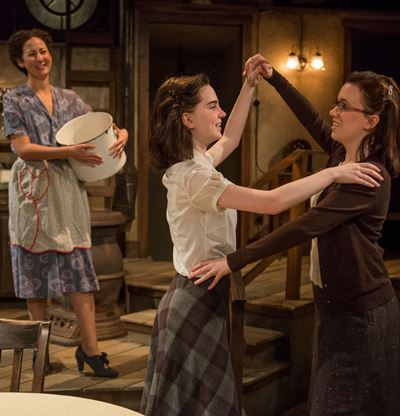 Mrs. Frank (Kristina Valada-Viars) delights in the joy of her dancing daughters, Anne (Sophie Thatcher) and Margot (Lila Morse). (Michael Brosilow)