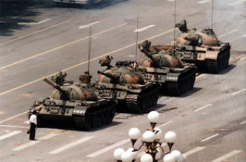 The iconic image of 'Tank Man' at Tiananmen Square in 1989, trying to block the way with his own body, was shot by Jeff Widener for AP. (Wikipedia)